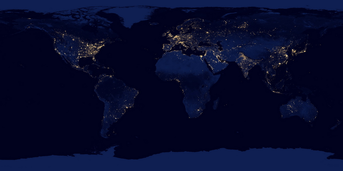 world lights at night against dark bodies of water