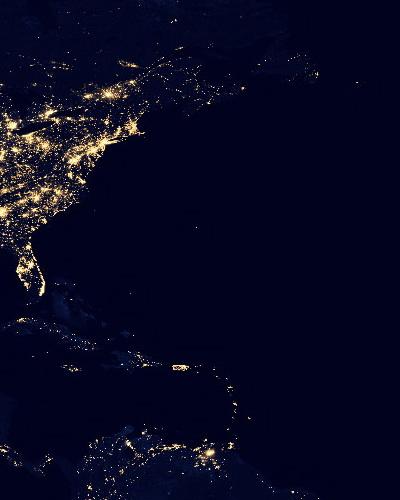 east coast USA lights at night against dark ocean