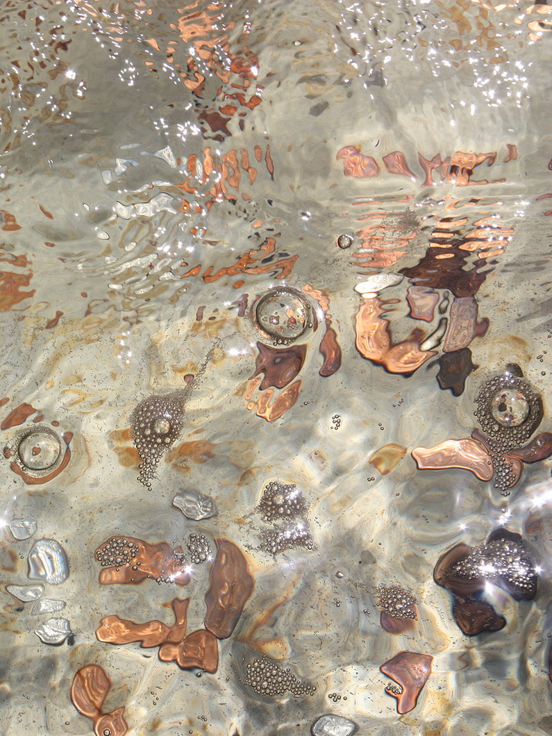 pennies under rippling water