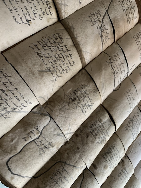 aged-looking scrolls lettered with a folktale